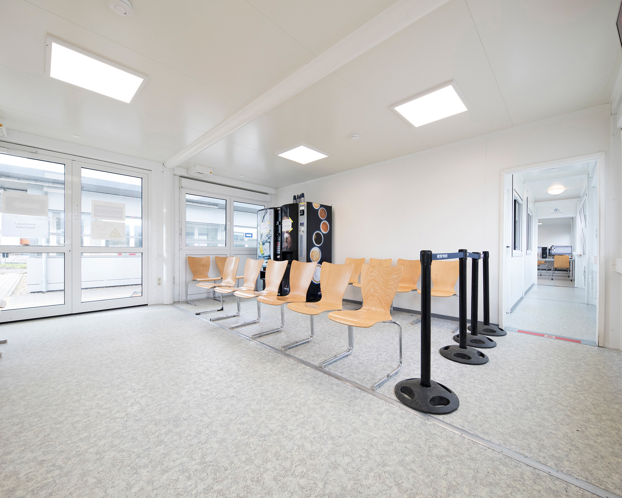 Double glass doors and a separate waiting area provide a friendly reception for the employees.